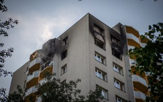 Smoke can still be seen billowing from balconies after a fire broke out in an apartment block in Bohumin, eastern Czech Republic on August 8, 2020, killing eleven people including three children. - Police originally reported ten dead in the fire in a 13-storey concrete block of flats in the city of Bohumin on the Czech-Polish border some 300 kilometres (190 miles) east of the capital Prague. (Photo by Lukas Kabon / AFP) (Photo by LUKAS KABON/AFP via Getty Images)