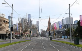 MELBOURNE, AUSTRALIA - AUGUST 11: Empty roads around Melbourne are seen on August 11, 2020 in Melbourne, Australia.  Metropolitan Melbourne  is under stage 4 lockdown restrictions, with people only allowed to leave home to give or receive care, shopping for food and essential items, daily exercise and work while an overnight curfew from 8pm to 5am is also in place. The majority of retail businesses are also closed. Other Victorian regions are in stage 3 lockdown. The restrictions, which came into effect from 2 August, have been introduced by the Victorian government as health authorities work to reduce community COVID-19 transmissions across the state. (Photo by Quinn Rooney/Getty Images)
