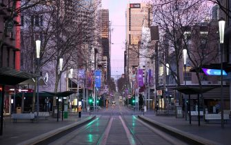 MELBOURNE, AUSTRALIA - AUGUST 11: A very quiet Bourke Street is seen on August 11, 2020 in Melbourne, Australia.  Metropolitan Melbourne  is under stage 4 lockdown restrictions, with people only allowed to leave home to give or receive care, shopping for food and essential items, daily exercise and work while an overnight curfew from 8pm to 5am is also in place. The majority of retail businesses are also closed. Other Victorian regions are in stage 3 lockdown. The restrictions, which came into effect from 2 August, have been introduced by the Victorian government as health authorities work to reduce community COVID-19 transmissions across the state. (Photo by Quinn Rooney/Getty Images)