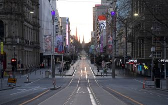 MELBOURNE, AUSTRALIA - AUGUST 11: A very quiet Bourke Street is seen on August 11, 2020 in Melbourne, Australia. Metropolitan Melbourne is under stage 4 lockdown restrictions, with people only allowed to leave home to give or receive care, shopping for food and essential items, daily exercise and work, while an overnight curfew from 8pm to 5am is also in place. The majority of retail businesses are also closed. Other Victorian regions are in stage 3 lockdown. The restrictions, which came into effect from 2 August, have been introduced by the Victorian government as health authorities work to reduce community COVID-19 transmissions across the state. (Photo by Quinn Rooney/Getty Images)