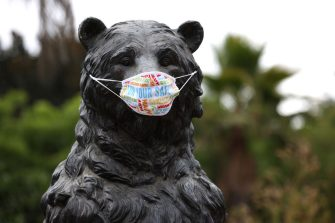 OAKLAND, CALIFORNIA - JULY 29: A protective mask is displayed on a bear statue at the Oakland Zoo on July 29, 2020 in Oakland, California. The Oakland Zoo reopened to the public after being closed for four months due to the coronavirus COVID-19 pandemic. 2,500 tickets will be available to the public each day and will be issued with staggered entry times. (Photo by Justin Sullivan/Getty Images)