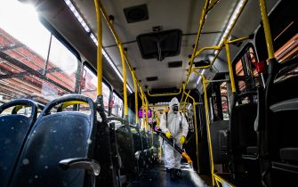 Military personnel from the Brazilian Armed Forces sanitizes a bus at the Santa Candida bus terminal to combat the spread of the the novel coronavirus, COVID-19, in Curitiba, Parana State, Brazil, on August 10, 2020. - The pandemic has killed at least 731,518 people worldwide, 101,049 of them in Brazil, since it surfaced in China late last year, according to a tally from official sources compiled by AFP at 1100 GMT on Monday. (Photo by Daniel CASTELLANO / AFP) (Photo by DANIEL CASTELLANO/AFP via Getty Images)