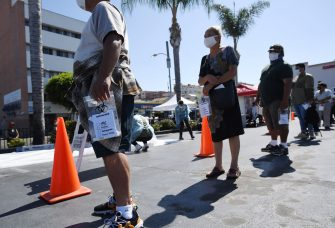People wait in line at a walk-up coronavirus testing location in Los Angeles, California, August 10, 2020, amid the COVID-19 pandemic. - Los Angeles County officials reported 1,920 new confirmed cases of coronavirus on August 10, bringing the total to at least 210,424 cases countywide. The county also added 19 new deaths of COVID-19 patients on August 10 bringing the total number of deaths countywide to 4,996. (Photo by Robyn Beck / AFP) (Photo by ROBYN BECK/AFP via Getty Images)