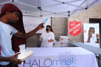 NEW YORK, NEW YORK - AUGUST 10: People receive free face masks at a Salvation Army Community Center  on August 10, 2020 in New York City. The masks, which are washable and were donated by the company HALO, were given out to individuals during the daily free lunch at the center. Currently, The United States has now surpassed 5 million confirmed cases of Covid-19 as of Sunday.  (Photo by Spencer Platt/Getty Images)