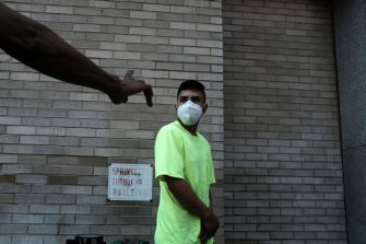 NEW YORK, NEW YORK - AUGUST 10: People wait in line for lunch and a free face mask at a Salvation Army Community Center  on August 10, 2020 in New York City. The masks, which are washable and were donated by the company HALO, were given out to individuals during the daily free lunch at the center. Currently, The United States has now surpassed 5 million confirmed cases of Covid-19 as of Sunday.  (Photo by Spencer Platt/Getty Images)