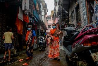 Residents walk inside the Dharavi slum in Mumbai on August 11, 2020. (Photo by INDRANIL MUKHERJEE / AFP) (Photo by INDRANIL MUKHERJEE/AFP via Getty Images)