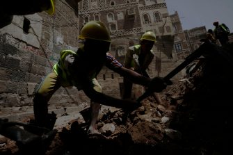 epa08599458 Yemenis work on the site of rain-collapsed buildings in the old city of Sana a, Yemen, 12 August 2020. According to reports, torrential rains and flooding in Yemen have claimed the lives of at least 170 people, including 19 children, and destroyed hundreds of houses and roads across the war-torn Arab country over the past few weeks.  EPA/YAHYA ARHAB