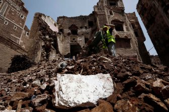 epa08599462 A Yemeni works on the site of rain-collapsed buildings in the old city of Sana a, Yemen, 12 August 2020. According to reports, torrential rains and flooding in Yemen have claimed the lives of at least 170 people, including 19 children, and destroyed hundreds of houses and roads across the war-torn Arab country over the past few weeks. EPA/YAHYA ARHAB  EPA-EFE/YAHYA ARHAB