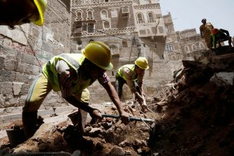 epa08599461 Yemenis work on the site of rain-collapsed buildings in the old city of Sana a, Yemen, 12 August 2020. According to reports, torrential rains and flooding in Yemen have claimed the lives of at least 170 people, including 19 children, and destroyed hundreds of houses and roads across the war-torn Arab country over the past few weeks.  EPA/YAHYA ARHAB