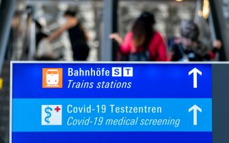 epa08606856 A view of an information sign leading to COVID-19 medical screening for people returning from risk countries at the international airport in Frankfurt am Main, Germany, 16 August 2020. The German government has made compulsory coronavirus disease (COVID-19) testing for people returning from risk countries amid a rise of infections. Germany has a large list of high-risk countries that is constantly updated and most recently it added several parts of Romania, along with Spain and Bulgaria to it.  EPA/RONALD WITTEK