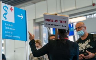epa08606854 A view of an information sign leading to COVID-19 medical screening for people returning from risk countries at the international airport in Frankfurt am Main, Germany, 16 August 2020. The German government has made compulsory coronavirus disease (COVID-19) testing for people returning from risk countries amid a rise of infections. Germany has a large list of high-risk countries that is constantly updated and most recently it added several parts of Romania, along with Spain and Bulgaria to it.  EPA/RONALD WITTEK