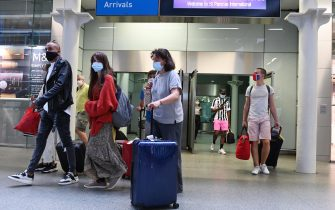 epa08603385 Passengers wearing face masks arrive in a Eurostar train from Paris, in St Pancras station in London, Britain, 14  August 2020. Britain's government announced a mandatory quarantine for passengers from France, Netherlands, Monaco and Malta as part of measures to contain the spread of coronavirus Covid-19 disease.  EPA/FACUNDO ARRIZABALAGA