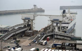 epa08603405 A DFDS ferry unloads vehicles at the Port of Dover in Dover, Britain, 14 August 2020. UK quarantine restrictions imposed on France come into force from Saturday 14 August 2020. The 14-day isolation requirement from 04:00 BST also applies to people arriving from the Netherlands, Monaco, Malta, Turks and Caicos, and Aruba.  EPA/NEIL HALL