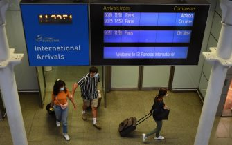 epa08605246 Travellers arrive back in the UK from Paris at St.Pancras International station in London, Britain, 15 August 2020. UK quarantine measures for France have come into force from 04.00 GMT on 15 August. Those travellers who missed the deadline will have to quarantine for two weeks.  EPA/ANDY RAIN