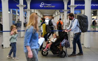 epa08604866 Travellers at St.Pancras International station in London, Britain, 15 August 2020. UK quarantine measures for France have come into force from 04.00 GMT 15 August. Travellers who missed the deadline will have to quarantine for two weeks.  EPA/ANDY RAIN