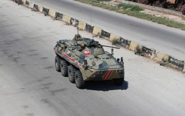 Russian armoured vehicles drive as part of a joint Turkish-Russian military patrol along the M4 highway, which links the northern Syrian provinces of Aleppo and Latakia, near Ariha in Syria's rebel-held northwestern Idlib province, on June 10, 2020. (Photo by OMAR HAJ KADOUR / AFP) (Photo by OMAR HAJ KADOUR/AFP via Getty Images)