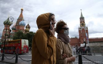 MOSCOW, RUSSIA - AUGUST,14 (RUSSIA OUT): Women wearing protective masks walk by Red Square in front of the St.Basile Cathedral, on August,14,2020, in Moscow, Russia. The requirement to wear masks and gloves to combat a spread of the Coronavirus (COVID-19) is still in effect in Moscow's region. (Photo by Mikhail Svetlov/Getty Images)