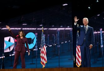 Senator from California and Democratic vice presidential nominee Kamala Harris and Former vice-president and Democratic presidential nominee Joe Biden wave from the stage socially distanced from each other at the end of the third day of the Democratic National Convention, being held virtually amid the novel coronavirus pandemic, at the Chase Center in Wilmington, Delaware on August 19, 2020. (Photo by Olivier DOULIERY / AFP) (Photo by OLIVIER DOULIERY/AFP via Getty Images)