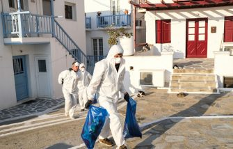 MYKONOS, GREECE - MAY 25: Contractors dressed in personal protective equipment (P.P.E.) remove debris from a home in the Little Venice neighborhood on May 25, 2020 in Mykonos, Greece. After months of being on lockdown due to the coronavirus, Greece will begin to ease travel restrictions on movement between the mainland and the countrys islands. (Photo by Byron Smith/Getty Images)