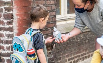 Illustration picture shows a teacher giving desinfecting gel to a pupil at the entrance of De Kleine Icarus school in Gent, Tuesday 02 June 2020. Schools for children under six years old are reopening today for everyone. Belgium is in its twelfth week of confinement in the ongoing corona virus crisis and the third week of the phase 2 of the deconfinement.  BELGA PHOTO JONAS D'HOLLANDER (Photo by JONAS D'HOLLANDER/BELGA MAG/AFP via Getty Images)