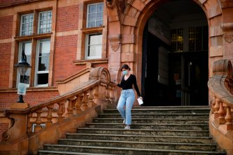 A student at Newham Collegiate Sixth Form leaves the school after receiving her A-Level results in east London on August 13, 2020. - English authorities reassured school pupils they would be graded fairly for exams missed because of the coronavirus, after the Scottish government was forced into a major U-turn on the issue. (Photo by Tolga Akmen / AFP) (Photo by TOLGA AKMEN/AFP via Getty Images)