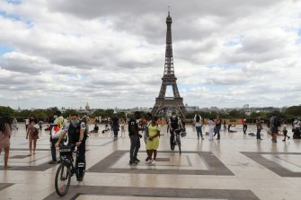 Bicycle police wearing face masks patrol  on the Trocadero esplanade, near the Eiffel Tower, on August 24, 2020, in Paris. - Wearing face masks open-air public places is mandatory in parts of the French capital as part of measures to curb the coronavirus outbreak. (Photo by Ludovic MARIN / AFP) (Photo by LUDOVIC MARIN/AFP via Getty Images)