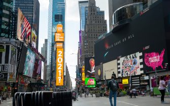 NEW YORK, NEW YORK - AUGUST 24: A countdown to 2021 clock is displayed on digital billboards at One Times Square as the city continues Phase 4 of re-opening following restrictions imposed to slow the spread of coronavirus on August 24, 2020 in New York City. The fourth phase allows outdoor arts and entertainment, sporting events without fans and media production. (Photo by Alexi Rosenfeld/Getty Images)