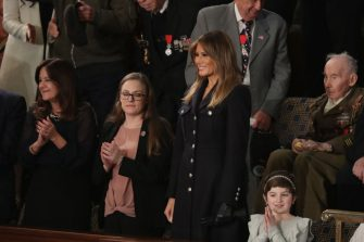 WASHINGTON, DC - FEBRUARY 05:  First lady Melania Trump and Ashley Evans, special guest of the President, attend the State of the Union address in the chamber of the U.S. House of Representatives on February 5, 2019 in Washington, DC. President Trump's second State of the Union address was postponed one week due to the partial government shutdown.  (Photo by Chip Somodevilla/Getty Images)