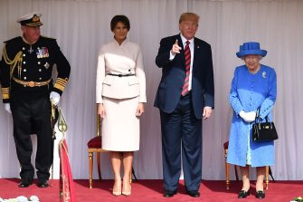 WINDSOR, ENGLAND - JULY 13:  Britain's Queen Elizabeth II (2R) stands with US President Donald Trump (R) and US First Lady Melania Trump (2L) on the dias in the Quadrangle during a ceremonial welcome at Windsor Castle on July 13, 2018 in Windsor, England.  Her Majesty welcomed the President and Mrs Trump at the dais in the Quadrangle of the Castle. A Guard of Honour, formed of the Coldstream Guards, gave a Royal Salute and the US National Anthem was played. The Queen and the President inspected the Guard of Honour before watching the military march past. The President and First Lady then joined Her Majesty for tea at the Castle.  (Photo by Ben Stansall - WPA Pool/Getty Images)