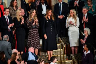 First Lady Melania Trump (C) is greeted by the audience, surrounded by family members (from L-R, Jared Kushner and Ivanka Trump, Lara Trump and Tiffany Trump), as she arrives for US President Donald Trump's State of the Union address at the US Capitol in Washington, DC on February 5, 2019. (Photo by MANDEL NGAN / AFP)        (Photo credit should read MANDEL NGAN/AFP via Getty Images)
