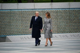 TOPSHOT - US President Donald Trump and First Lady Melania Trump tour the World War II Memorial after taking part in a ceremony commemorating the 75th anniversary of Victory in Europe, in Washington, DC, on May 8, 2020. (Photo by MANDEL NGAN / AFP) (Photo by MANDEL NGAN/AFP via Getty Images)