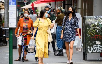 NEW YORK, NEW YORK - AUGUST 29: People wear protective face masks in Korea Town as the city continues Phase 4 of re-opening following restrictions imposed to slow the spread of coronavirus on August 29, 2020 in New York City. The fourth phase allows outdoor arts and entertainment, sporting events without fans and media production. (Photo by Noam Galai/Getty Images)