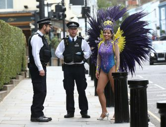 Police officers on patrol engage in conversation with pilates instructor Juliana Campos as she poses in her carnival costume in Notting Hill, London, on what would have been the weekend of the Notting Hill Carnival, after the 2020 carnival was cancelled due to the coronavirus pandemic, with events being streamed online. (Yui Mok / IPA/Fotogramma, London - 2020-08-30) p.s. la foto e' utilizzabile nel rispetto del contesto in cui e' stata scattata, e senza intento diffamatorio del decoro delle persone rappresentate