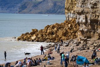 "BURTON BRADSTOCK, UNITED KINGDOM - AUGUST 29: General view of the 9,000 ton cliff fall on August 29, 2020 in Burton Bradstock, Dorset, England. The fall happened at Hive Beach near the village of Burton Bradstock shortly before 06:30 BST, Dorset Council said. Fire crews using thermal imaging equipment were called in to check for any trapped casualties but nothing was found. The council described it as a ""huge"" rock fall and said recent heavy rain had made cliffs unstable. (Photo by Finnbarr Webster/Getty Images)"