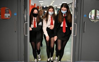 GLASGOW, SCOTLAND - AUGUST 12: Pupils return to St Paul's High School for the first time since the start of the coronavirus lockdown nearly five months ago on August 12, 2020 in Glasgow, Scotland. Pupils will return to more of Scotland's schools today, as the fallout continues from the government's decision to upgrade exam results. (Photo by Jeff J Mitchell/Getty Images)