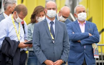 "French Minister for Education Jean-Michel Blanquer (C) attends the podium ceremony of ""la course by le tour"" women's race prior to the 1st stage of the 107th edition of the Tour de France cycling race, 156 km between Nice and Nice, on August 29, 2020. (Photo by Stuart Franklin / POOL / AFP) (Photo by STUART FRANKLIN/POOL/AFP via Getty Images)"