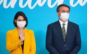 BRASILIA, BRAZIL - AUGUST 28: President of Brazil Jair Bolsonaro and First Lady Michelle Bolsonaro react during celebration of National Volunteer Day amidst the coronavirus(COVID-19) pandemic at the Planalto Palaceon August 28, 2020 in Brasilia. Brazil has over 3.761,000 confirmed positive cases of Coronavirus and has over 118,649 deaths. (Photo by Andressa Anholete/Getty Images)