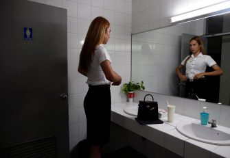 epa08645100 A Thai transgender student Siwakorn Thatsanasorn adjusts her female university student uniform in a female toilet at Thammasat University Rangsit Campus in Pathum Thani province, Thailand, 24 August 2020 (issued 04 September 2020). Outdated regulations at most schools and universities in Thailand mean many transgender people are forced to wear a uniform in class that does not match their gender identity. Since June, Thammasat University has removed those regulations, allowing 20 year-old Siwakorn 'Buzzy' Thatsanasorn to wear the outfit of her choice at school. But Siwakorn says that transgenders in primary and secondary schools are still not allowed to choose gender-appropriate school uniforms.  EPA/RUNGROJ YONGRIT  ATTENTION: This Image is part of a PHOTO SET