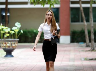 epa08645099 A Thai transgender student Siwakorn Thatsanasorn wearing female university student uniform walks at Thammasat University Rangsit Campus in Pathum Thani province, Thailand, 24 August 2020 (issued 04 September 2020). Outdated regulations at most schools and universities in Thailand mean many transgender people are forced to wear a uniform in class that does not match their gender identity. Since June, Thammasat University has removed those regulations, allowing 20 year-old Siwakorn 'Buzzy' Thatsanasorn to wear the outfit of her choice at school. But Siwakorn says that transgenders in primary and secondary schools are still not allowed to choose gender-appropriate school uniforms.  EPA/RUNGROJ YONGRIT  ATTENTION: This Image is part of a PHOTO SET