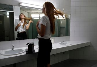 epa08645098 A Thai transgender student Siwakorn Thatsanasorn wearing female university student uniform flips her hair in a female toilet at Thammasat University Rangsit Campus in Pathum Thani province, Thailand, 24 August 2020 (issued 04 September 2020). Outdated regulations at most schools and universities in Thailand mean many transgender people are forced to wear a uniform in class that does not match their gender identity. Since June, Thammasat University has removed those regulations, allowing 20 year-old Siwakorn 'Buzzy' Thatsanasorn to wear the outfit of her choice at school. But Siwakorn says that transgenders in primary and secondary schools are still not allowed to choose gender-appropriate school uniforms.  EPA/RUNGROJ YONGRIT  ATTENTION: This Image is part of a PHOTO SET