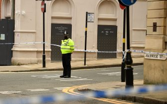 """A police officer mans a cordon at the junction of Church Street and Barwick Street, following a major stabbing incident in the centre of Birmingham, central England, on September 6, 2020. - British police declared a """"major incident"""" early on September 6 after multiple people were stabbed in the centre of England's second city Birmingham. Violence broke out at about 12:30 am (2330 GMT Saturday) in and around the Arcadian Centre, a popular venue filled with restaurants, nightclubs and bars. (Photo by Oli SCARFF / AFP) (Photo by OLI SCARFF/AFP via Getty Images)"""