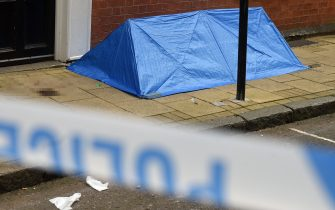 """A small forensics tent is seen at the junction of Church Street and Barwick Street, following a major stabbing incident in the centre of Birmingham, central England, on September 6, 2020. - British police declared a """"major incident"""" early on September 6 after multiple people were stabbed in the centre of England's second city Birmingham. Violence broke out at about 12:30 am (2330 GMT Saturday) in and around the Arcadian Centre, a popular venue filled with restaurants, nightclubs and bars. (Photo by Oli SCARFF / AFP) (Photo by OLI SCARFF/AFP via Getty Images)"""