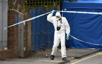 """A police forensics officer gathers evidence inside a cordon on Irving Street, following a major stabbing incident in the centre of Birmingham, central England, on September 6, 2020. - British police declared a """"major incident"""" early on September 6 after multiple people were stabbed in the centre of England's second city Birmingham. Violence broke out at about 12:30 am (2330 GMT Saturday) in and around the Arcadian Centre, a popular venue filled with restaurants, nightclubs and bars. (Photo by Oli SCARFF / AFP) (Photo by OLI SCARFF/AFP via Getty Images)"""