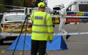 """Police forensics officers gather evidence near to forensics tents and evidence markers inside a cordon on Irving Street, following a major stabbing incident in the centre of Birmingham, central England, on September 6, 2020. - British police declared a """"major incident"""" early on September 6 after multiple people were stabbed in the centre of England's second city Birmingham. Violence broke out at about 12:30 am (2330 GMT Saturday) in and around the Arcadian Centre, a popular venue filled with restaurants, nightclubs and bars. (Photo by Oli SCARFF / AFP) (Photo by OLI SCARFF/AFP via Getty Images)"""