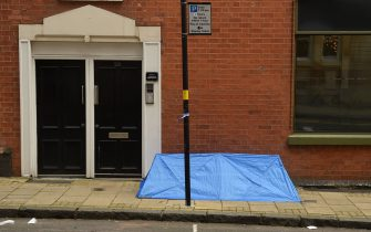"""A small forensics tent is seen on Barwick Street, following a major stabbing incident in the centre of Birmingham, central England, on September 6, 2020. - British police declared a """"major incident"""" early on September 6 after multiple people were stabbed in the centre of England's second city Birmingham. Violence broke out at about 12:30 am (2330 GMT Saturday) in and around the Arcadian Centre, a popular venue filled with restaurants, nightclubs and bars. (Photo by Oli SCARFF / AFP) (Photo by OLI SCARFF/AFP via Getty Images)"""