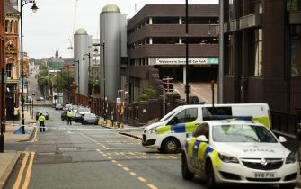 """Police guard a cordon on Livery Street following a major stabbing incident in the centre of Birmingham, central England, on September 6, 2020. - British police declared a """"major incident"""" early on September 6 after multiple people were stabbed in the centre of England's second city Birmingham. Violence broke out at about 12:30 am (2330 GMT Saturday) in and around the Arcadian Centre, a popular venue filled with restaurants, nightclubs and bars. (Photo by Oli SCARFF / AFP) (Photo by OLI SCARFF/AFP via Getty Images)"""
