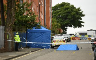 """A police officer stands near to forensics tents and evidence markers at a cordon on Irving Street, following a major stabbing incident in the centre of Birmingham, central England, on September 6, 2020. - British police declared a """"major incident"""" early on September 6 after multiple people were stabbed in the centre of England's second city Birmingham. Violence broke out at about 12:30 am (2330 GMT Saturday) in and around the Arcadian Centre, a popular venue filled with restaurants, nightclubs and bars. (Photo by Oli SCARFF / AFP) (Photo by OLI SCARFF/AFP via Getty Images)"""