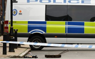 """A opened drain cover lies in the road near to a cordon on Edmund Street following a major stabbing incident in the centre of Birmingham, central England, on September 6, 2020. - British police declared a """"major incident"""" early on September 6 after multiple people were stabbed in the centre of England's second city Birmingham. Violence broke out at about 12:30 am (2330 GMT Saturday) in and around the Arcadian Centre, a popular venue filled with restaurants, nightclubs and bars. (Photo by Oli SCARFF / AFP) (Photo by OLI SCARFF/AFP via Getty Images)"""
