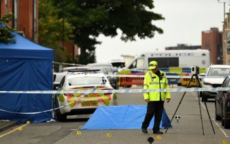 """Police gather evidence near to forensics tents and evidence markers inside a cordon on Irving Street, following a major stabbing incident in the centre of Birmingham, central England, on September 6, 2020. - British police declared a """"major incident"""" early on September 6 after multiple people were stabbed in the centre of England's second city Birmingham. Violence broke out at about 12:30 am (2330 GMT Saturday) in and around the Arcadian Centre, a popular venue filled with restaurants, nightclubs and bars. (Photo by Oli SCARFF / AFP) (Photo by OLI SCARFF/AFP via Getty Images)"""