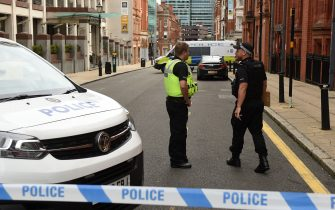 """Police guard a cordon on Edmund Street following a major stabbing incident in the centre of Birmingham, central England, on September 6, 2020. - British police declared a """"major incident"""" early on September 6 after multiple people were stabbed in the centre of England's second city Birmingham. Violence broke out at about 12:30 am (2330 GMT Saturday) in and around the Arcadian Centre, a popular venue filled with restaurants, nightclubs and bars. (Photo by Oli SCARFF / AFP) (Photo by OLI SCARFF/AFP via Getty Images)"""